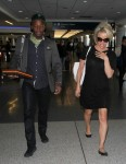 Pamela Anderson is seen at LAX in Los Angeles December 31-2015 x5